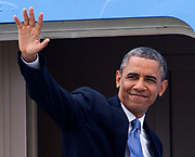 President Barack Obama waves as he boards Air Force One from Los Angeles International Airport  in Los Angeles, Friday, June 7, 2013., to Palms Springs to meet with the Chinese President Xi Jinping for two days of talks on high-stakes issues, including cybersecurity and North Korea's nuclear threats.