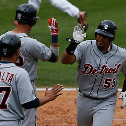 Mar 12, 2013; Clearwater, FL, USA; Detroit Tigers catcher Brayan Pena (55) celebrates with teammates left fielder Quintin Berry (52) and shortstop Jhonny Peralta (27) after hitting a two run homerun  against the Philadelphia Phillies during the top of the fifth inning of a spring training game at Bright House Field. Mandatory Credit: Derick E. Hingle-USA TODAY Sports