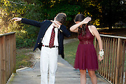 "Teens ""dabbing."" Dabbing is a popular dance in 2016. They practice before going to homecoming dance."