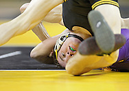 December 8, 2011: Iowa Hawkeyes Matt McDonough tries to turn Northern Iowa Panthers Cruse Aarhus in the 125 pound bout of the NCAA wrestling dual between the Northern Iowa Panthers and the Iowa Hawkeyes at Carver-Hawkeye Arena in Iowa CIty, Iowa on Thursday, December 8, 2011. McDonough defeated Aarhus 10-1 and Iowa defeated Northern Iowa 38-4.
