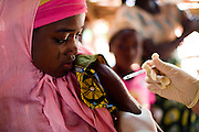 A girl gets vaccinated against meningitis at a MSF vaccination site in Fagougaou, Niger on Friday April 17, 2009..