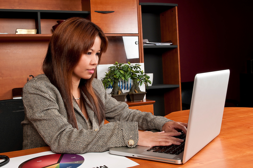 Young woman working in small business office.