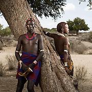 Portrait of Bola Gooda and Koto (R) under an Acacia tree.