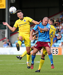 Ollie Clarke of Bristol Rovers challenges Stephen Dawson of Scunthorpe United  - Mandatory by-line: Matt McNulty/JMP - 06/08/2016 - FOOTBALL - Glanford Park - Scunthorpe, England - Scunthorpe United v Bristol Rovers - Sky Bet League One