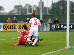 Caroline Weir of Bristol Academy Women defeats Danielle Gibbons of Liverpool Ladies to open the scoring at Stoke Gifford Stadium - Mandatory by-line: Paul Knight/JMP - Mobile: 07966 386802 - 04/10/2015 -  FOOTBALL - Stoke Gifford Stadium - Bristol, England -  Bristol Academy Women v Liverpool Ladies FC - FA Women's Super League