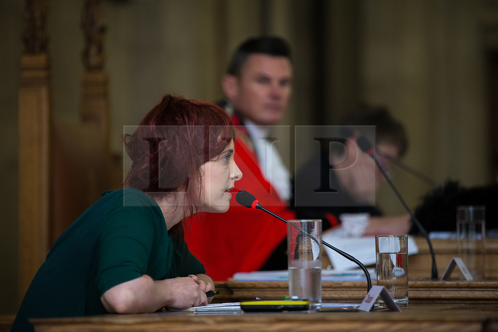 © Licensed to London News Pictures . 13/07/2016. Manchester , UK . Manchester Evening News reporter JENNIFER WILLIAMS speaks to the council on the response to an MEN reader petition on the future of Piccadilly Gardens . Proceedings at a Manchester City Council meeting , at the Town Hall in Manchester . Photo credit : Joel Goodman/LNP
