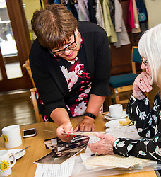 Pictured: Fiona McQueen was shown pictures from an ex-nurses time in the NHS<br /> <br /> Scotland's Chief Nursing Officer (CNO) Fiona McQueen met members of the NHS Retirement Fellowship as the 70th anniversary of the NHS approaches.<br /> <br /> Ger Harley | EEm 21 June 2018