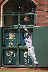 SAN FRANCISCO, CA - APRIL 09:  Yasiel Puig #66 of the Los Angeles Dodgers catches a fly ball hit off the bat of Brandon Belt (not pictured) of the San Francisco Giants during the seventh inning at AT&T Park on April 9, 2016 in San Francisco, California.  (Photo by Jason O. Watson/Getty Images) *** Local Caption *** Yasiel Puig