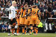 Hull celebrate Hull City midfielder Moses Odubajo goal during the Sky Bet Championship play-off first leg match between Derby County and Hull City at the iPro Stadium, Derby, England on 14 May 2016. Photo by Alan Franklin.
