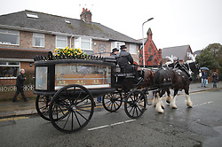 © Licensed to London News Pictures. 28/03/2018. Liverpool, UK. The funeral of comedian and performer Sir Ken Dodd , who died on 11th March 2018 at the age of 90 . Friends and well-wishers gather outside Ken Dodd's home ahead of the horse-drawn cortege winding through Liverpool from Dodd's lifetime home in Knotty Ash to Liverpool Cathedral . Photo credit: Joel Goodman/LNP