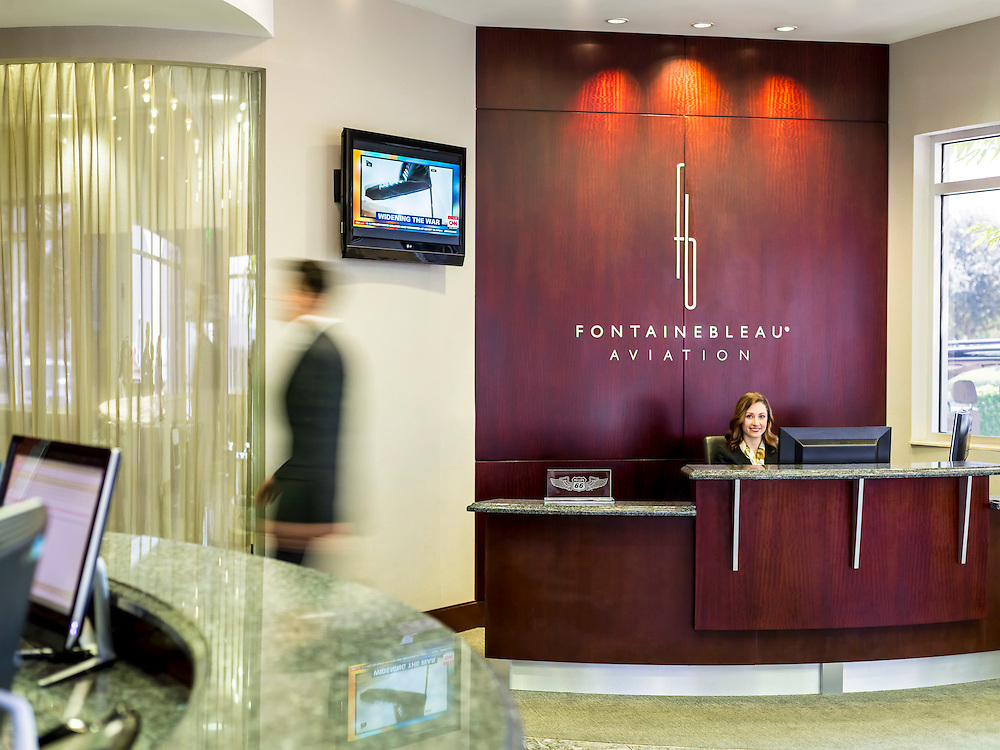Fontainebleau Aviation concierge desk in their lobby at Opa-locka Executive Airport, near Miami.  Created by aviation photographer John Slemp of Aerographs Aviation Photography. Clients include Goodyear Aviation Tires, Phillips 66 Aviation Fuels, Smithsonian Air & Space magazine, and The Lindbergh Foundation.  Specialising in high end commercial aviation photography and the supply of aviation stock photography for commercial and marketing use.