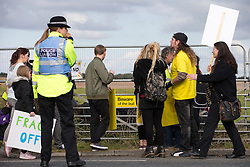 © Licensed to London News Pictures . 08/10/2016 . Lancashire , UK . Demonstrators pass the farmland on Preston New Road on which the permission to frack has been granted . Anti fracking demonstration against the government and fracking firm Cuadrilla at Maple Farm on Preston New Road near Preston in Lancashire , following Communities and Local Government Minister Sajid Javid's decision to overturn Lancashire County Council's decision to ban fracking on the site . Photo credit : Joel Goodman/LNP