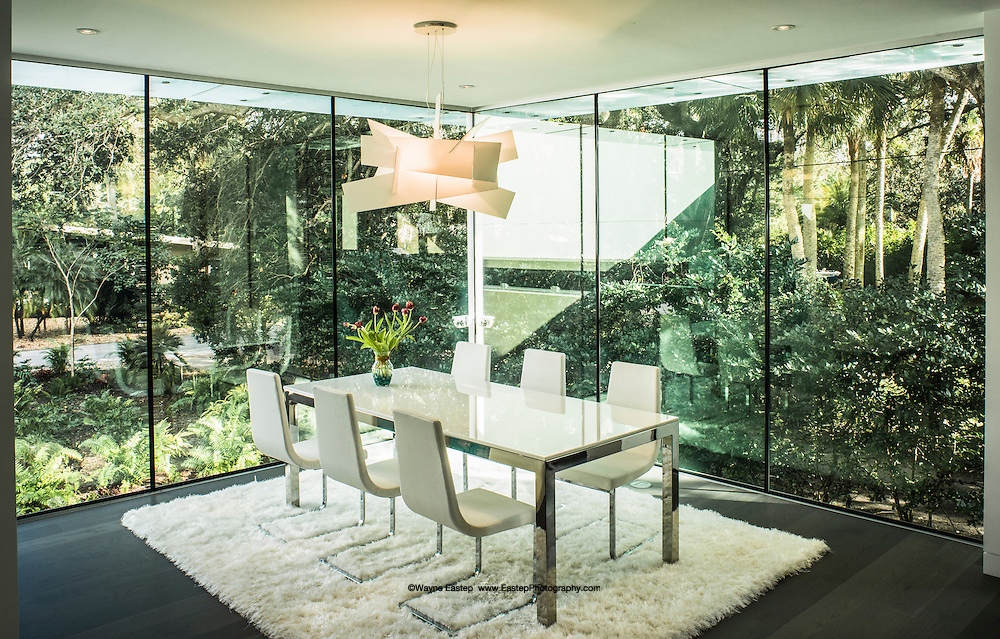 Dining room with 1 inch tick glass panels and glass sunscreens.
