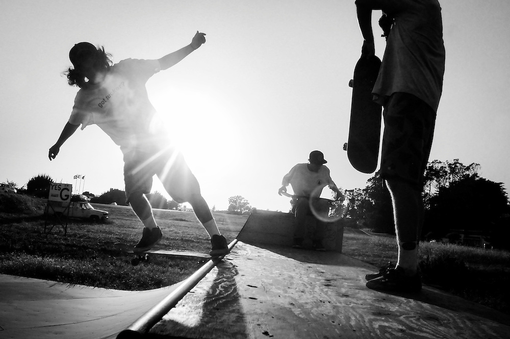 Skateboarders ride on a skate ramp in Half Moon Bay, California.