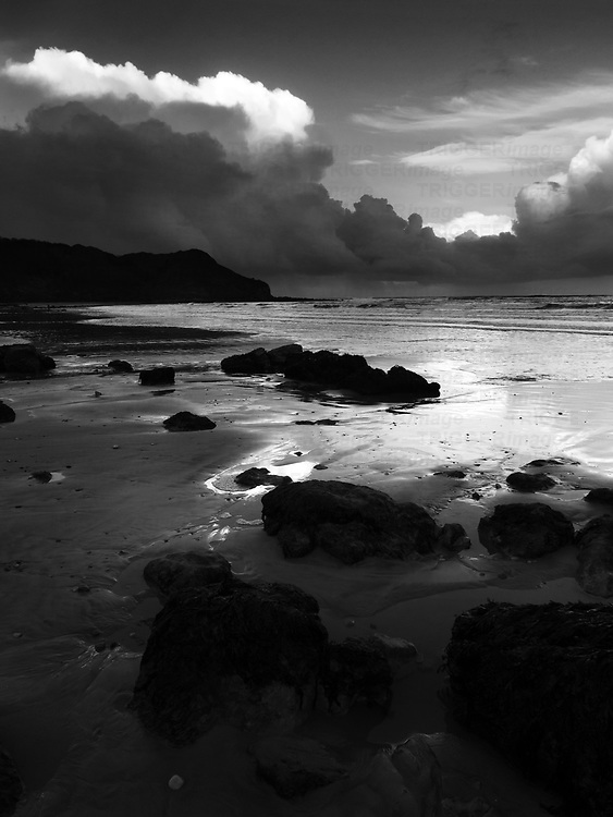 Rocks on the Beach and Osgodby Point or Knipe Point at Dusk Cayton Bay Scarborough North Yorkshire England