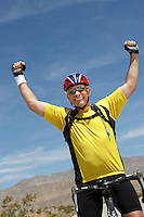 Cyclist riding bicycle and cheering portrait
