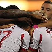 Fabian Espindola, New York Red Bulls, is congratulated by team mates after scoring his sides first goal during the New York Red Bulls V New England Revolution, Major League Soccer regular season match at Red Bull Arena, Harrison, New Jersey. USA. 5th October 2013. Photo Tim Clayton