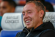 Swansea City manager Steve Cooper laughing, smiling during the EFL Sky Bet Championship match between Queens Park Rangers and Swansea City at the Kiyan Prince Foundation Stadium, London, England on 21 August 2019.