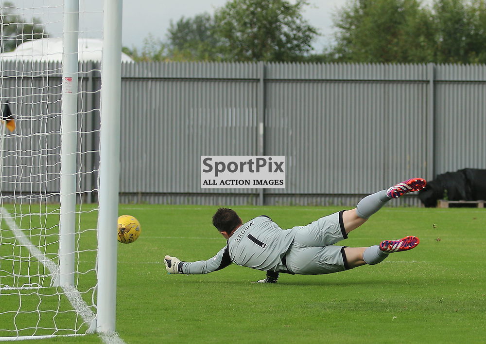 Mark Brown has to be lively to save this in bound shot  during the Dumbarton FC V Queen of the South FC Scottish Championship 22th August 2015 <br /> <br /> (c) Andy Scott | SportPix.org.uk