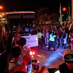 Jun 21, 2012; Miami, FL, USA; Miami Heat fans celebrate outside as the team bus for the Oklahoma City Thunder passes following the 2012 NBA Finals at the American Airlines Arena. Miami won 121-106. Mandatory Credit: Derick E. Hingle-US PRESSWIRE