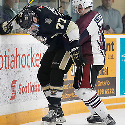 TRENTON, ON  - MAY 4,  2017: Canadian Junior Hockey League, Central Canadian Jr. &quot;A&quot; Championship. The Dudley Hewitt Cup. Game 6 between the Trenton Golden Hawks and The Dryden GM Ice Dogs.  Cory Dennis #12 of the Dryden GM Ice Dogs makes the hit on Anthony Sorrentino #77 of the Trenton Golden Hawks <br /> (Photo by Amy Deroche / OJHL Images)