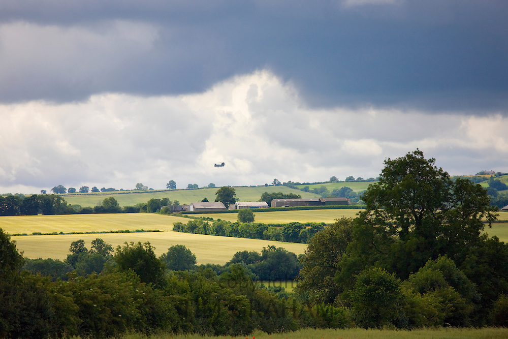 Chinook helicopter in the distance in the sky above Sibford Ferris, The Cotswolds, Oxfordshire, UK