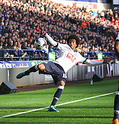 Derik Osede clears during the Sky Bet Championship match between Bolton Wanderers and Leeds United at the Macron Stadium, Bolton, England on 24 October 2015. Photo by Pete Burns.