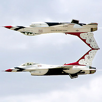 Two F-16's mirror each other in an aerobatic move at the Grand Forks Air Force Base.