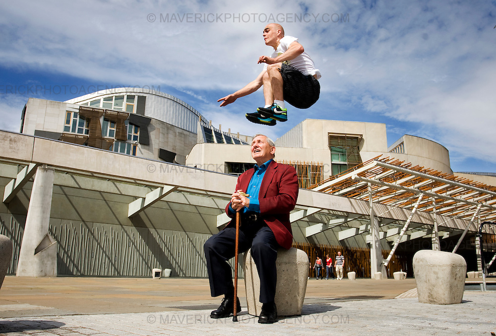 ".Stefan Brown leaps over Jimi King at the Scottish Parliament to launch the new ""Urbathon"" event to be held in Scotlands capital....HUNDREDS of runners will have the chance to jump, climb and crawl their way through the capital in the first  10 kilometre race of its kind to take place in Scotland which involves obstacle course challenges. ..Picture Michael Hughes/Maverick"