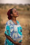 Mekya Ganemo, 24, is 8 months pregnant with her first child. <br /> <br /> &quot;I must become a mother because I am a woman,&quot; says Mekya Ganemo, 24. &quot;I am happy to meet this child. When we have a baby we celebrate by preparing special foods like porridge and performing a coffee ceremony. The whole family celebrates together. If the baby is a boy the celebration is grander because he will grow up and stay with the family and bring a wife into the family.&quot;<br /> <br /> She's been receiving fortified Corn Soy Blend (CSB) from Catholic Relief Services through generous funding from the American people and USAID since she was three months along. The porridge only takes 10 minutes to prepare and has all the nutrients a mother needs to ensure a healthy baby. A health extension worker regularly checks in on Mekya to make sure that she is using the CSB correctly and helping to prepare her for childbirth and caring for a newborn. Expectant and lactating mothers and children under 5 who are showing signs of undernourishment in the community receive the CSB.