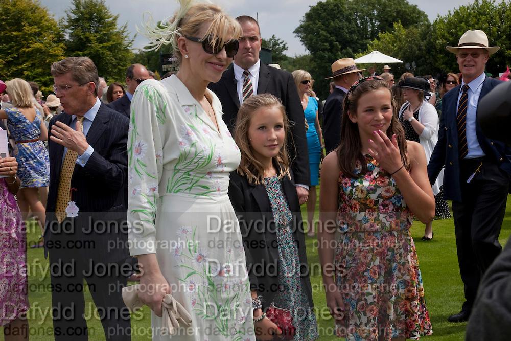 COURTNEY LOVE;LADY ELOISE GORDON-LENNOX;, MIA SELMAN;  IN THE PADDOCK, Glorious Goodwood. Ladies Day. 28 July 2011. <br /> <br />  , -DO NOT ARCHIVE-© Copyright Photograph by Dafydd Jones. 248 Clapham Rd. London SW9 0PZ. Tel 0207 820 0771. www.dafjones.com.