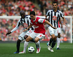 25.09.2010, Emirates Stadium, London, ENG, PL, Arsenal vs west Bromwich Albion, im Bild Arsenal's Samir Nasri battles with West Brom's Youssouf Malumba, EXPA Pictures © 2010, PhotoCredit: EXPA/ IPS/ Mark Greenwood *** ATTENTION *** UK AND FRANCE OUT! / SPORTIDA PHOTO AGENCY