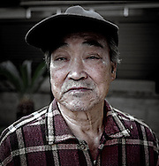 Mr. Misaki, captain of the Fukuryu Maru (Lucky Dragon), which wandered into restricted zone during hydrogen bomb test at Bikini Island in 1954 and showered with radioactive ash, at his family's home in Yaizu, Japan.