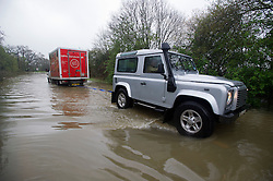 © London News Pictures. 29/04/2012. Ingatestone, UK. A Sainsbury's supermarket delivery van being pulled from flood water by a Land Rover after getting stuck in the town of Ingateston in Essex on April 29, 2012 . The banks of the nearby river Wid broke it's banks following torrential rainfall. Photo credit : Ben Cawthra /LNP