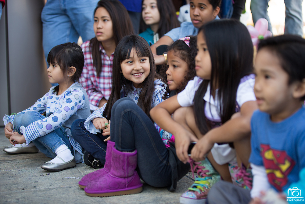 Children watch Kawailehua Hula Ohana perform to the beat of live drums during the City of Milpitas 60th Anniversary Family Day at Milpitas City Hall in Milpitas, California, on January 26, 2014. (Stan Olszewski/SOSKIphoto)