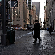 Old man walking on fifth avenue