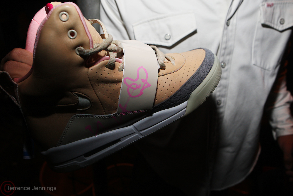 Devin Acosta with his signed Nike sneaker ' AirYeezys ' at The Persona Magazine Launch Party hosted by Russell Simmons held at the Griffen on September 11, 2009