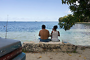 A couple enjoys breakfast overlooking the beach south of Garapan where US marines first landed in Saipan on 22 February 2011. .Photographer: Robert Gilhooly