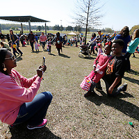Thomas Wells | BUY at PHOTOS.DJOURNAL.COM<br /> Donna Parker, left, gets quick photo of her daughter, Blakley, 4, and son, Brayden, 10, following Saturday's Easter Egg hunt at Ballard Park.