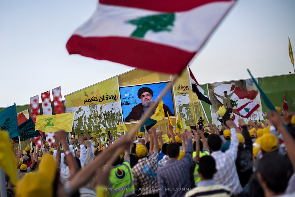"""Hezbollah leader Hassan Nasrallah delivers a speech through a video link to party supporters on the occasion of Liberation Day, the day Israel withdrew from south Lebanon in 2000, in Mashgara, Lebanon. In the speech Nasrallah confirmed for the first time that Hezbollah were actively fighting in Syria, saying, """"we will not rely on anyone ... like all the battles before this one: We will be its people, its men, and we will be the ones who bring it victory."""""""
