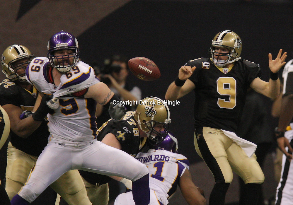 Jan 24, 2010; New Orleans, LA, USA; Minnesota Vikings defensive end Jared Allen (69) strips the ball from New Orleans Saints quarterback Drew Brees (9)during a 31-28 overtime victory by the New Orleans Saints over the Minnesota Vikings in the 2010 NFC Championship game at the Louisiana Superdome. Mandatory Credit: Derick E. Hingle-US PRESSWIRE