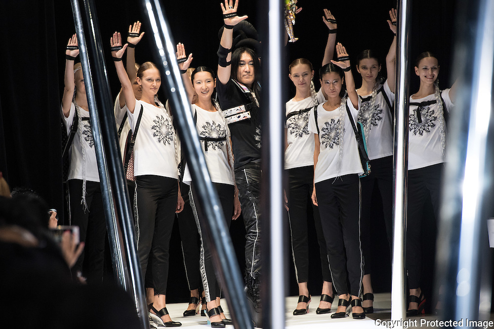 OCTOBER 21: Keiichiro Yuri and the models after the presentation of his collection at the Amazon Fashion Week Tokyo's 2017 Spring/Summer show under way at Shibuya Hikarie in Tokyo on Oct. 21, 2016. and other locations through 23rd. Nearly 50 fashion brands and companies will hold their shows at several locations through 23rd.. 21/10/2016-Tokyo, JAPAN