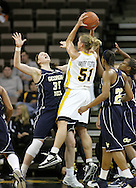 28 NOVEMBER 2007: Iowa forward Krista VandeVenter (51) puts up a shot while being defended by Georgia Tech forward Brigitte Ardossi (35) in the second half of Georgia Tech's 76-57 win over Iowa in the Big Ten/ACC Challenge at Carver-Hawkeye Arena in Iowa City, Iowa on November 28, 2007.
