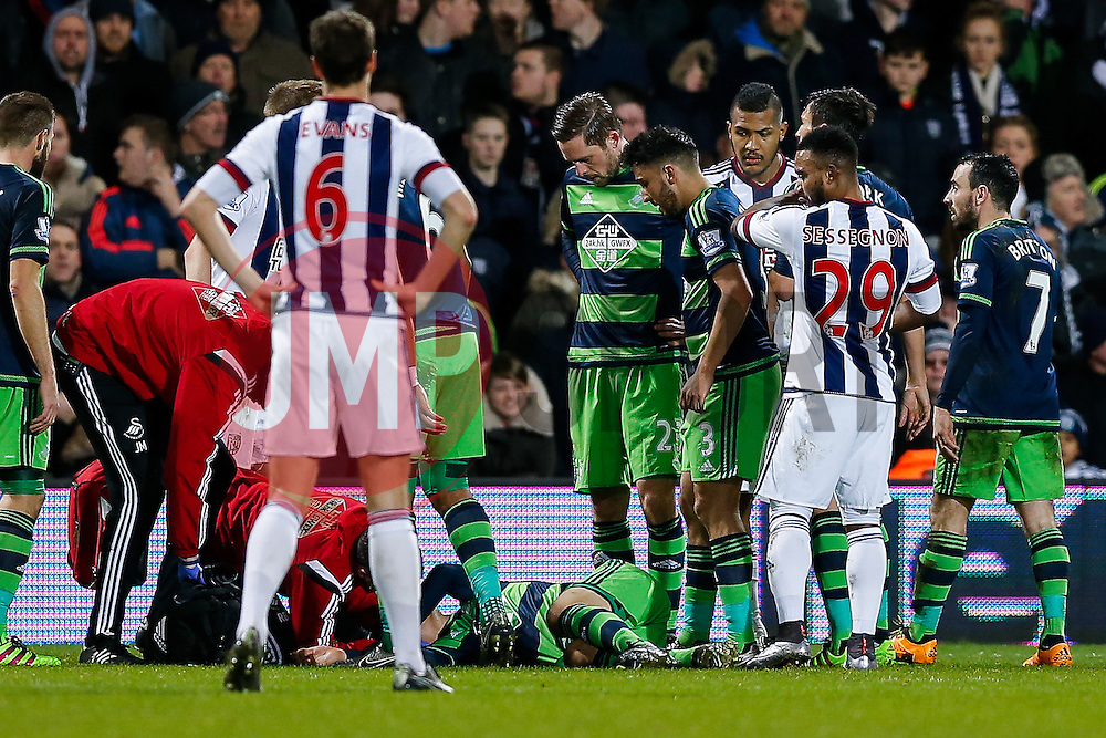 Ki Sung-Yueng of Swansea City receives treatment and has to be stretchered off after appearing to clash heads with Stephane Sessegnon of West Bromwich Albion - Mandatory byline: Rogan Thomson/JMP - 02/02/2016 - FOOTBALL - The Hawthornes - West Bromwich, England - West Bromwich Albion v Swansea City - Barclays Premier League.