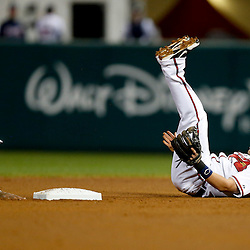 Mar 7, 2013; Lake Buena Vista, FL, USA; Atlanta Braves shortstop Tyler Pastornicky (1) falls to the ground after colliding on a force out at second base with Detroit Tigers first baseman Prince Fielder (28) during the top of the fourth inning of a spring training game at Champion Stadium. Mandatory Credit: Derick E. Hingle-USA TODAY Sports