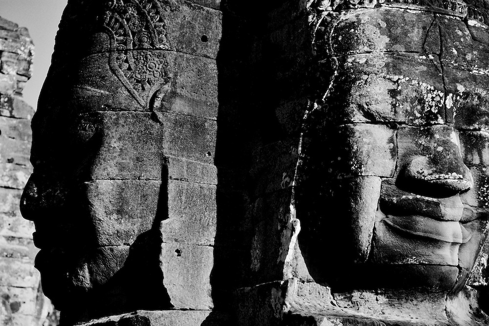 The smiling faces of Avalokiteshvara at the Bayon temple in Angkor Thom city shot in Black and White.<br />