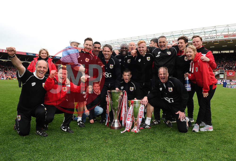 Bristol City back room staff are pictured with the Sky Bet League One and JPT trophy's  - Photo mandatory by-line: Joe Meredith/JMP - Mobile: 07966 386802 - 03/05/2015 - SPORT - Football - Bristol - Ashton Gate - Bristol City v Walsall - Sky Bet League One