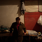 A local IDP stands beside her improvised bed at a Soviet era bomb shelter in Petrovskiy district, Donetsk. The daily routine of the almost hundred people living here for the past four months, can be tedious as the regular shellfire between DNR rebels and the Ukrainian National Guard is a constant threat that constrain them to stay underground most of the time.