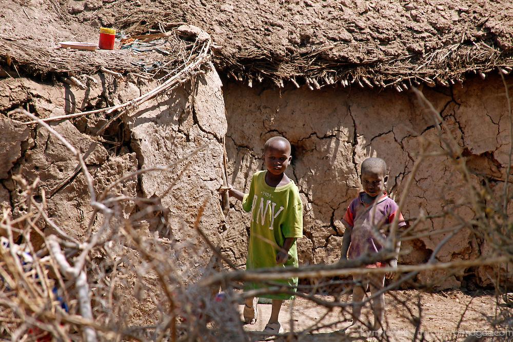 Africa, Kenya, Amboseli. Two young Maasai children in their village in Amboseli.