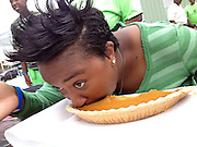 Timberly Moore of Memphis Tennessee takes part in a pumpkin pie eating contest. She said she does not ever want to eat pumpkin pie again. Photo by Karen Pulfer Focht